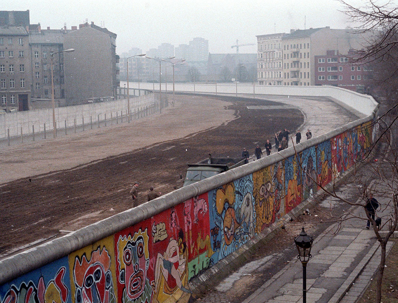 The view of the Berlin Wall as painted by Thierry Noir from the window of the squat where Thierry Noir lived in 1980s Berlin.