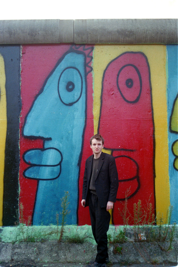 Thierry Noir at the Berlin Wall in the 1980s