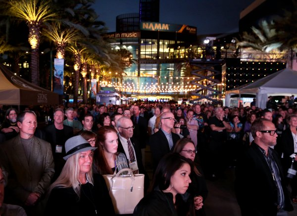 ANAHEIM, CA - JANUARY 21: Convention goers enjoy a concert by singer-songwriter Graham Nash at the 2016 NAMM Show Opening Day at the Anaheim Convention Center on January 21, 2016 in Anaheim, California. (Photo by Jesse Grant/Getty Images for NAMM)